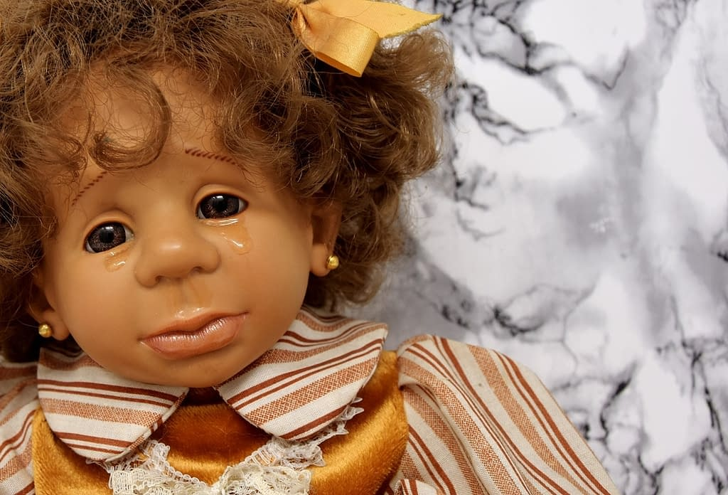 crying doll, to illustrate mourning over the loss of in-person church services